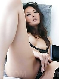 Risa Murakami Asian with round jugs turns clit on with vibrator