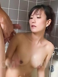 Manami Komukai Asian shows hot curves and sucks tool in bathtub