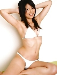 Rina Sasamoto in bath suit is in mood for some exercises