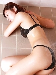 Miu Nakamura shows hot butt in black thong in the water
