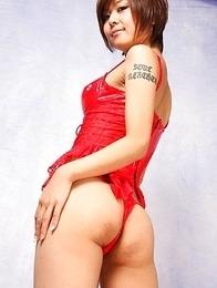 Miho Kotosaki exposes hot curves in red latex and stockings