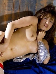 Ray Aoi babe caresses her big boobs and shows spicy behind