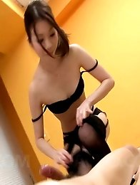 Nao Kojima Asian rubs dick with feet in nylon and rides it well