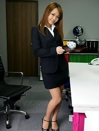 Sexy girl Saki posing in her office