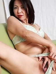 Asian MILF teasing her lovely cunt